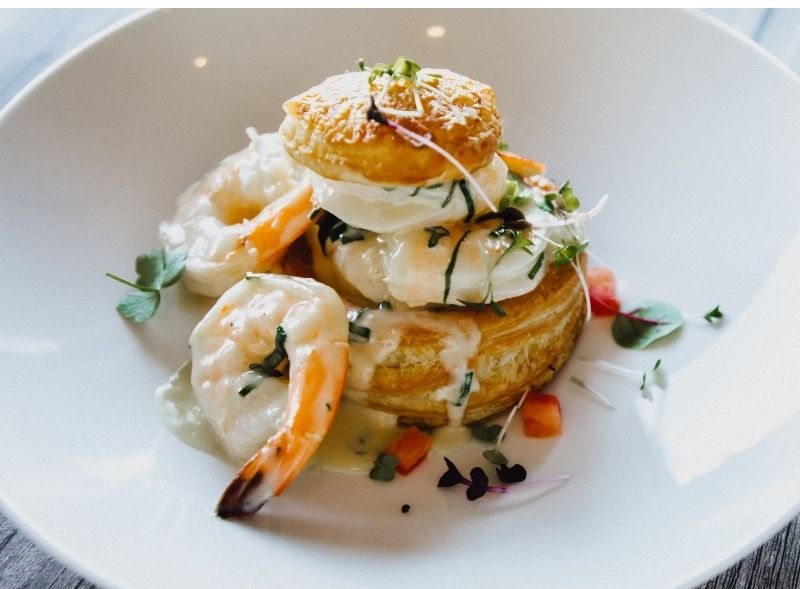 Shrimp, poached egg and puff pastry dish
