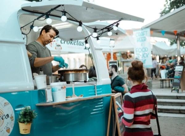 Food truck business ideas - blue food truck in market  by Arturo Rey on Unsplash