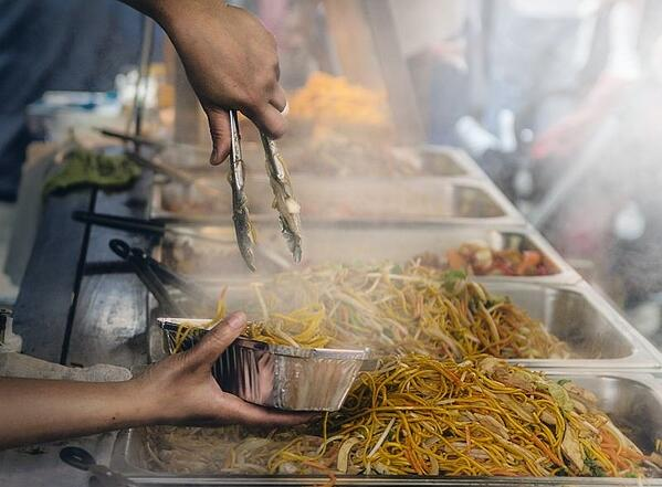 Street food serving up noodles from truck_Photo by James Sutton on Unsplash