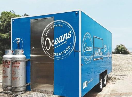 Blue fish and trip food trailer_Photo by Vlad Kutepov on Unsplash