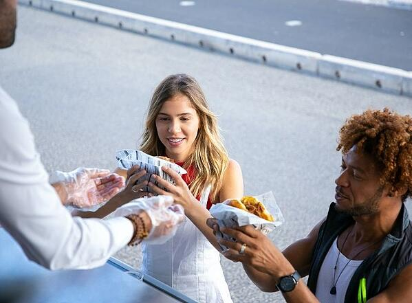 Man and Woman receiving burgers from a food truck_Photo by Kampus Production from Pexels