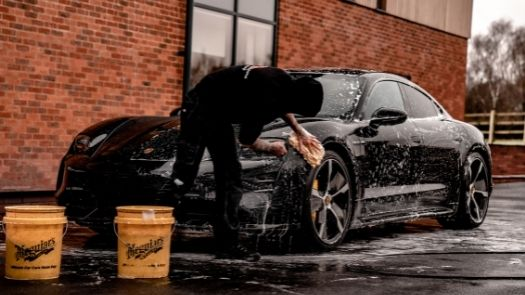 Hand washing sports car as part of vehicle wrap aftercare - credit Brad Starkey from Unsplash