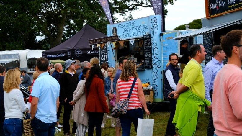 Food truck business ideas - people queuing for a food truck at event